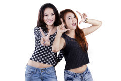 Two teenage girls having fun in studio Royalty Free Stock Photos