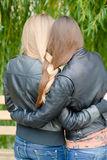 Two teenage girls having their long hair twisted Stock Photography