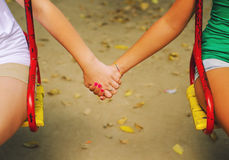 Two teenage girls holding hands. On beautiful autumn day stock photos