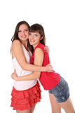 Two teenage girls hugging Royalty Free Stock Images