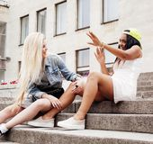Two teenage girls infront of university building smiling, having. Fun traveling europe, lifestyle people concept close up royalty free stock photo