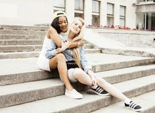 Two teenage girls infront of university building smiling, having fun traveling europe, lifestyle people concept Stock Image