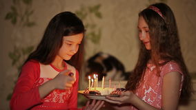 Two teenage girls lighting candles on birthday stock video footage