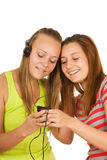 Two teenage girls listening to music Royalty Free Stock Photo