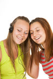 Two teenage girls listening to music Stock Photo