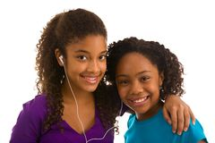 Two teenage girls listening to music Royalty Free Stock Image