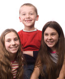 Two teenage girls and little boy smiling Royalty Free Stock Photos