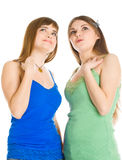 Two teenage girls are looking up Stock Photography