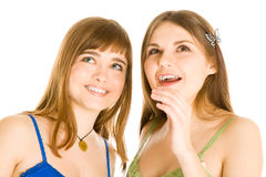 Two teenage girls are looking up Stock Images