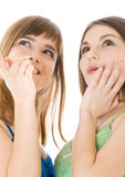 Two teenage girls looking up Stock Image