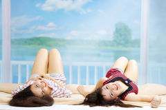 Two Teenage Girls Lying Royalty Free Stock Photography