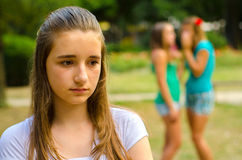 Two teenage girls making fun of the third Royalty Free Stock Images