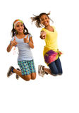 Two teenage girls in mid-air Stock Photography