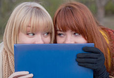 Two teenage girls outdoors Stock Images