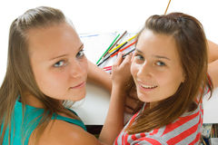 Two teenage girls paint Royalty Free Stock Photo
