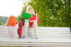 Two teenage girls at park Stock Photography