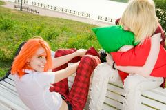 Two teenage girls at park Royalty Free Stock Photo