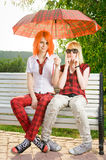 Two teenage girls at park Stock Images