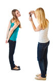 Two teenage girls photographing on camera Royalty Free Stock Image