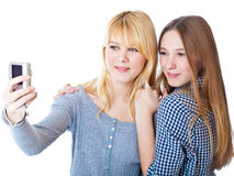 Two teenage girls photographing on camera Stock Images