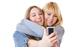 Two teenage girls photographing on camera Royalty Free Stock Photography