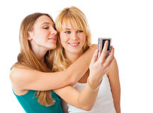 Two teenage girls photographing on camera Stock Photography