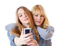 Two teenage girls photographing on camera Royalty Free Stock Images