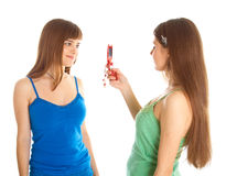 Two teenage girls photographing on mobile phone Royalty Free Stock Photo