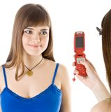 Two teenage girls photographing on mobile phone Stock Image