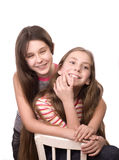 Two teenage girls playing isolated on white Stock Photography
