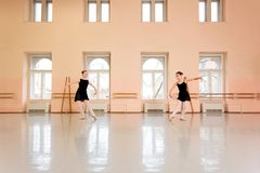 Two teenage girls practicing classical ballet stock photo