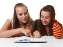 Two teenage girls  reading Royalty Free Stock Images