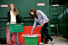 Two teenage girls recycling plastic bottles Royalty Free Stock Photography
