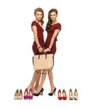 Two teenage girls in red dresses with bag Stock Photos