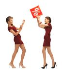Two teenage girls in red dresses with percent sign Stock Photos