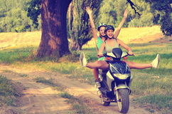 Two teenage girls riding motorcycle. On the countryside Royalty Free Stock Photos