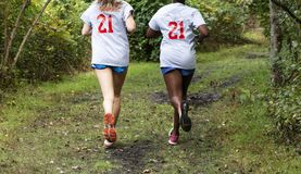 Two teenage girls running in the woods stock photos