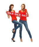 Two teenage girls with sale sign Royalty Free Stock Image