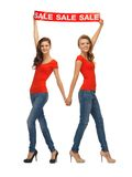 Two teenage girls with sale sign stock photos