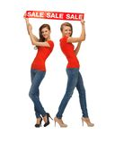 Two teenage girls with sale sign Stock Photo