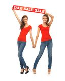Two teenage girls with sale sign Stock Image