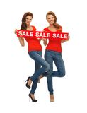 Two teenage girls with sale sign Stock Photography