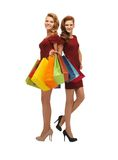 Two teenage girls with shopping bags Royalty Free Stock Image