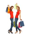 Two teenage girls with shopping bags Royalty Free Stock Images