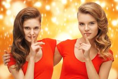 Two teenage girls showing hush gesture Stock Photography