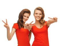 Two teenage girls showing victory sign Stock Photography