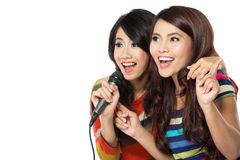 Two teenage girls singing Royalty Free Stock Photography
