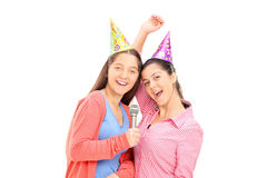 Two teenage girls singing on a microphone Stock Photo