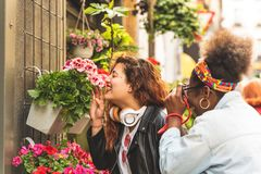 Two Teenage Girls Smelling Flowers stock photography