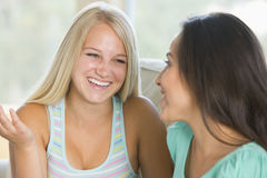 Two Teenage Girls Smiling To Each Other Royalty Free Stock Photography